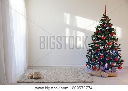 Christmas tree in a white room for Christmas with gifts 2
