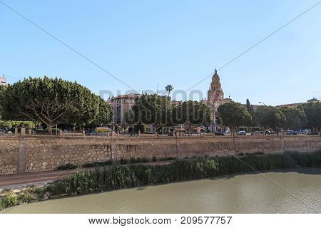 MURCIA, SPAIN - MAY 19, 2017: It is view of the Segura River embankment and the historic center of city.