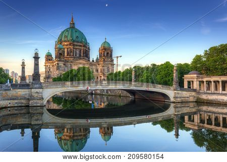 Berlin Cathedral Berliner Dom reflected in Spree River at dawn, Germany
