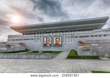 PYONGYANG.NORTH KOREA-OCTOBER 12.2017: Tribune with portraits of the leaders in the main square of the city