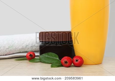Two jars of cream berries and a towel. daily care