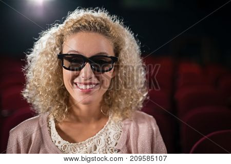 Young woman watching movie in theatre