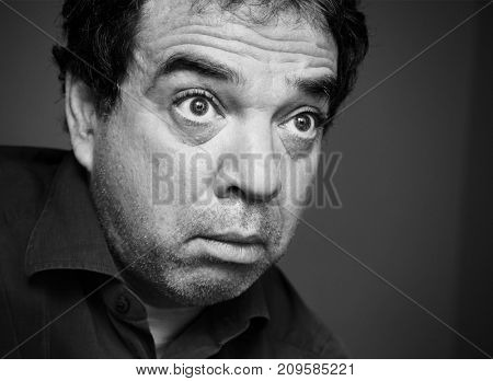 Black and white close-up portrait of a surprised man