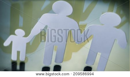 Family silhouettes with children isolated on yellow background, conceptual image