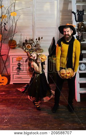 Girl And Bearded Man With Happy Faces In Carnival Room