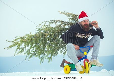 Excited Cyclist Shouting In Santa Hat And Sporty Wear
