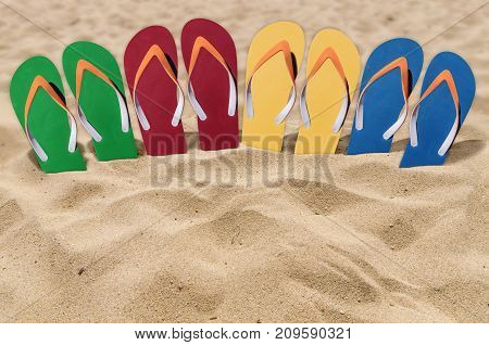 Man lifestyle four relax flip flops on orange sandy beach