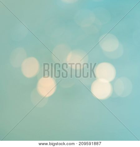 Blue Festive vintage glittering Christmas background. Bokeh Abstract glitter lights and stars with blurry lights.