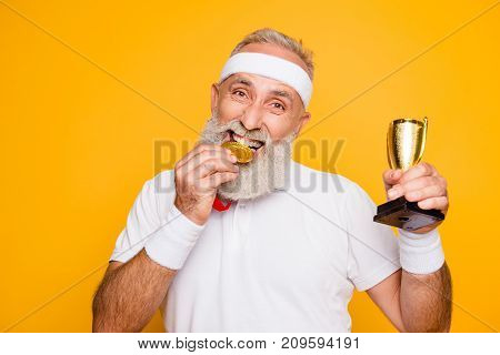 Active Emotional Cool Grandpa Holding Reward, Eating The Metal Sign Of Respect. Body, Health, Care,