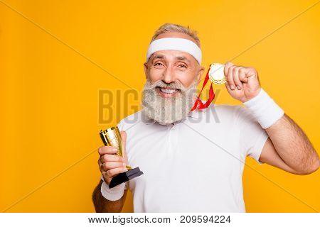Close Up Portrait Of Crazy Comic Emotional Cool Grandpa Holding Precious Reward. Body, Health, Care,