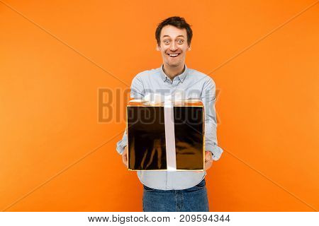 Mimicry And Crazy Concept. Young Adult Happiness Man, Looking At Camera With Funny Rabbit Face, And