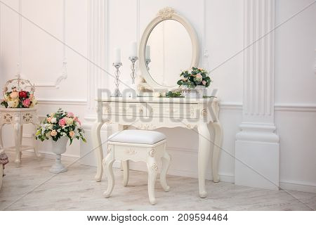 Boudoir table. Details of the interior of the bedroom for girls and make-up, hairstyles with a mirror