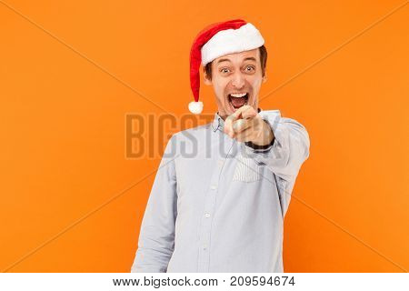 Hey You! It's New Year! Attractive Man Pointing Finger At Camera, And Toothy Smiling. Focus On Face.
