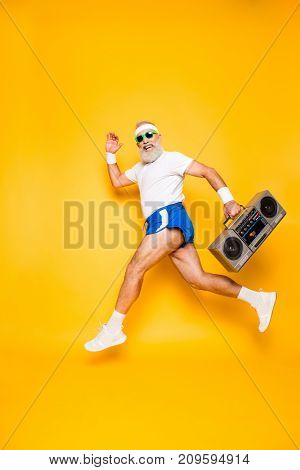 Dreamy Cheerful Excited Sporty Aged Funny Sexy Grandpa In Eyewear With Recorder In Hand. Old School,