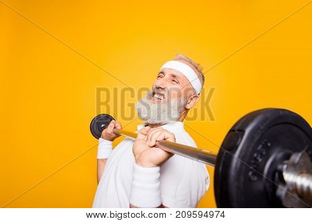 Comic, Confident Cool Grey Haired Grandpa With Humor Grimace Exercising Holding Equipment, Lifts It