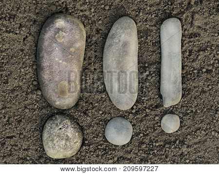 exclamation mark is made of two sea stones