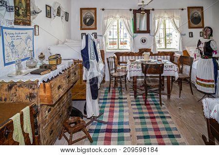 DINIAS ROMANIA - NOVEMBER 29 2016: Interior of Serbian farmhouse the Banat region (part of Transylvania) Romania. Accommodation of ethnic Serbian.
