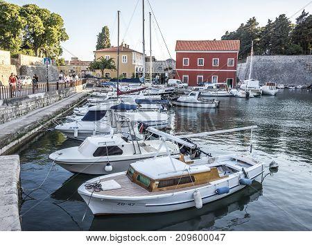 ZADAR, CROATIA - JULY 14, 2017: Pleasure boats and fishing boats on the pier in Fosa Bay in the spa town of Zadar in Croatia.