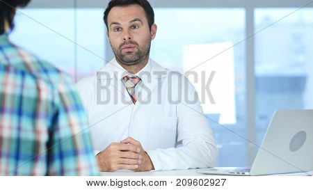 Doctor Talking With Patient About Health Care