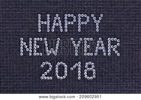 Wish HAPPY NEW YEAR 2018 is made rhinestones crystal color on a black canvas background