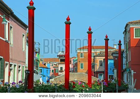 Burano Island In Italy Colorful Houses And Red Poles