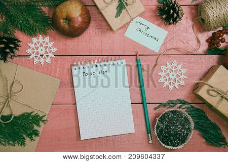 Preparation Of Christmas Gifts. Gift Boxes Are Packed With Kraft Paper Decored Branches Fir. To-do L
