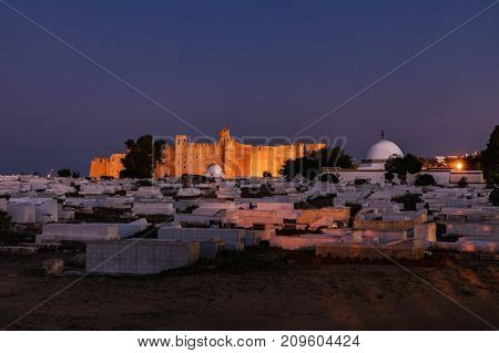 Night view on an Arabic cemetery next to Ribat in Monastir at the evening Tunisia