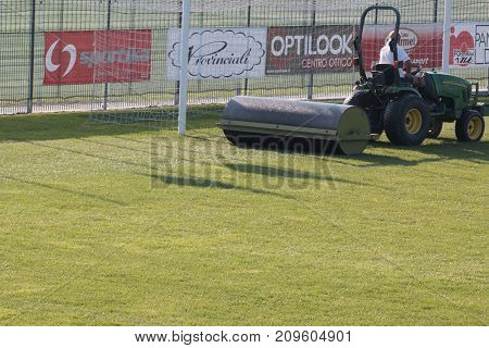 Parma, Italy - september 2015: Worker Drives Lawn Equipment in Soccer Pitch before Match