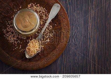 jar of homemade tahini with sesame seeds - food and drink