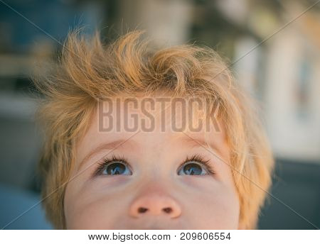 Child Eyes Closeup. Beautiful Baby Looking Up, Cute Baby Face For Advertising On Top. Cute Funny Boy