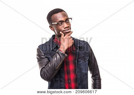 Handsome African Man With Thoughtful Skeptical Expression, Holding Hand On His Chin. Black Male With