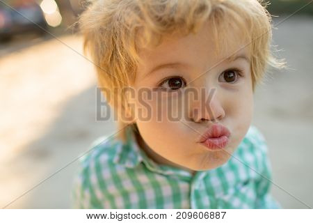 Kiss, Kissing Boy. Boy In Love, Funny Face Of Cute Kid Close Up. Beautiful Toddler Child Makes Kiss