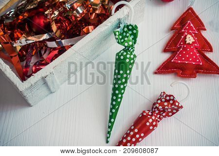 Beautiful christmas background with colorful candies and decor on white wooden background