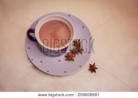 Cocoa In A Violet Mug On Golden Background