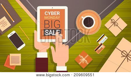 Hand Holding Digital Tablet With Cyber Monday Big Sale Message, Online Shopping Poster Over Cell Smart Phone, Credit Cards And Office Stuff On Workplace, Angle View Vector Illustration