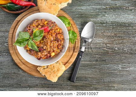 Plate with chili con carne on table