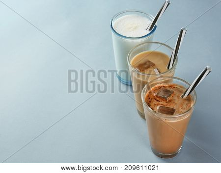 Glasses with different protein shakes on table