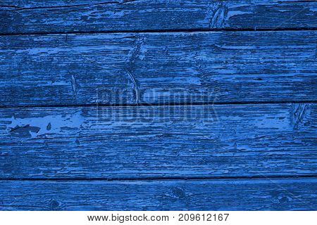 Wooden boards blue color paint textured background.
