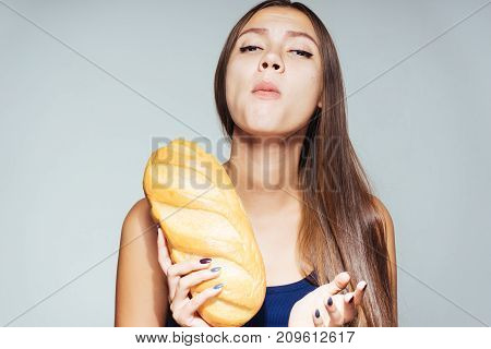 young beautiful girl wants to lose weight, but eats harmful white bread