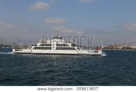 ISTANBUL TURKEY - SEPTEMBER 16 2017: Istanbul Deniz Otobusleri ferry passing from European to Asian side of Istanbul. 18 ferries in 3 different types carry passengers and vehicles between Sirkeci and Harem.