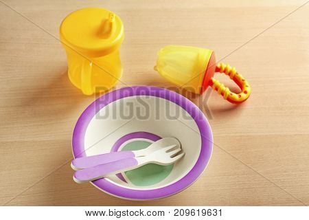 Bright baby dishware on table