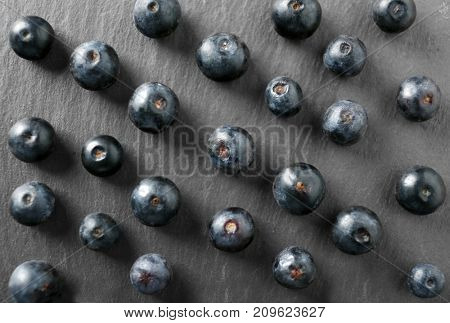 Fresh acai berries on dark background