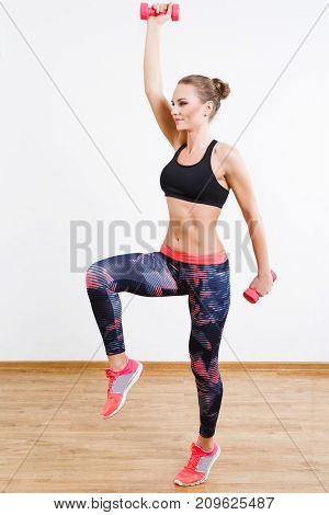 Pretty Girl Doing Physical Exercises At Gym
