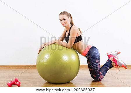 Pretty Girl Doing Physical Exercises With Fitball At Gym