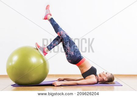 Young Girl Doing Physical Exercises With Fitball At Gym