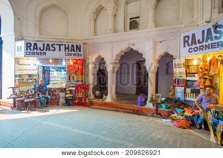 DELHI, INDIA - SEPTEMBER 25 2017: Unidentified people sitting and selling inside the Bazaar in the Red Fort in Delhi, India. Meena Bazaar, built by Mukarmat Khan 300 years ago, was the first covered bazaar in India.