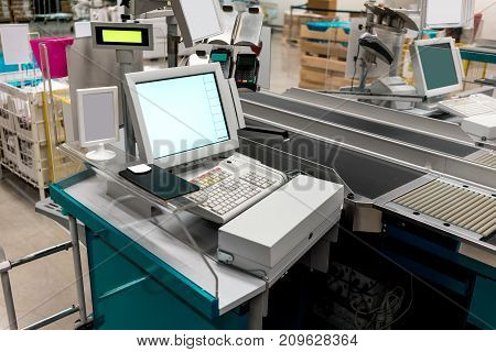 Empty cash desk with payment terminal in supermarket