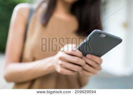 Business woman holding cellphone