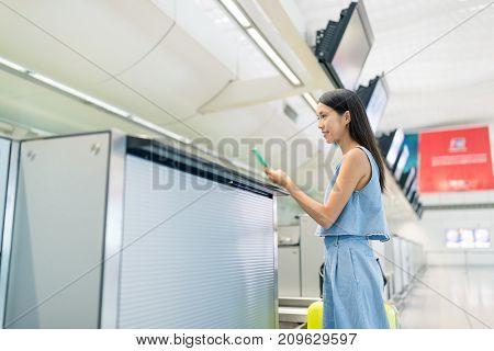 Woman check in Hong Kong airport