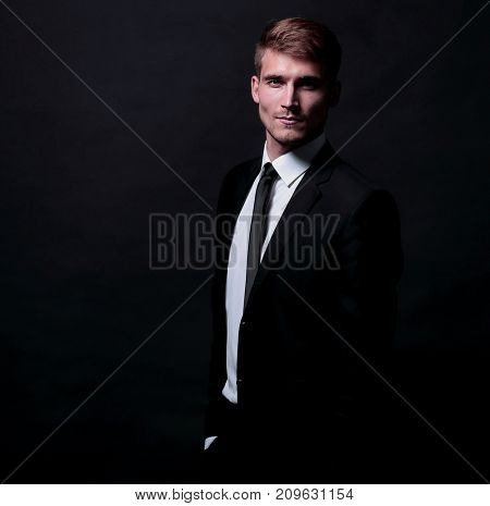 Full-length portrait of business man   isolated  on black background